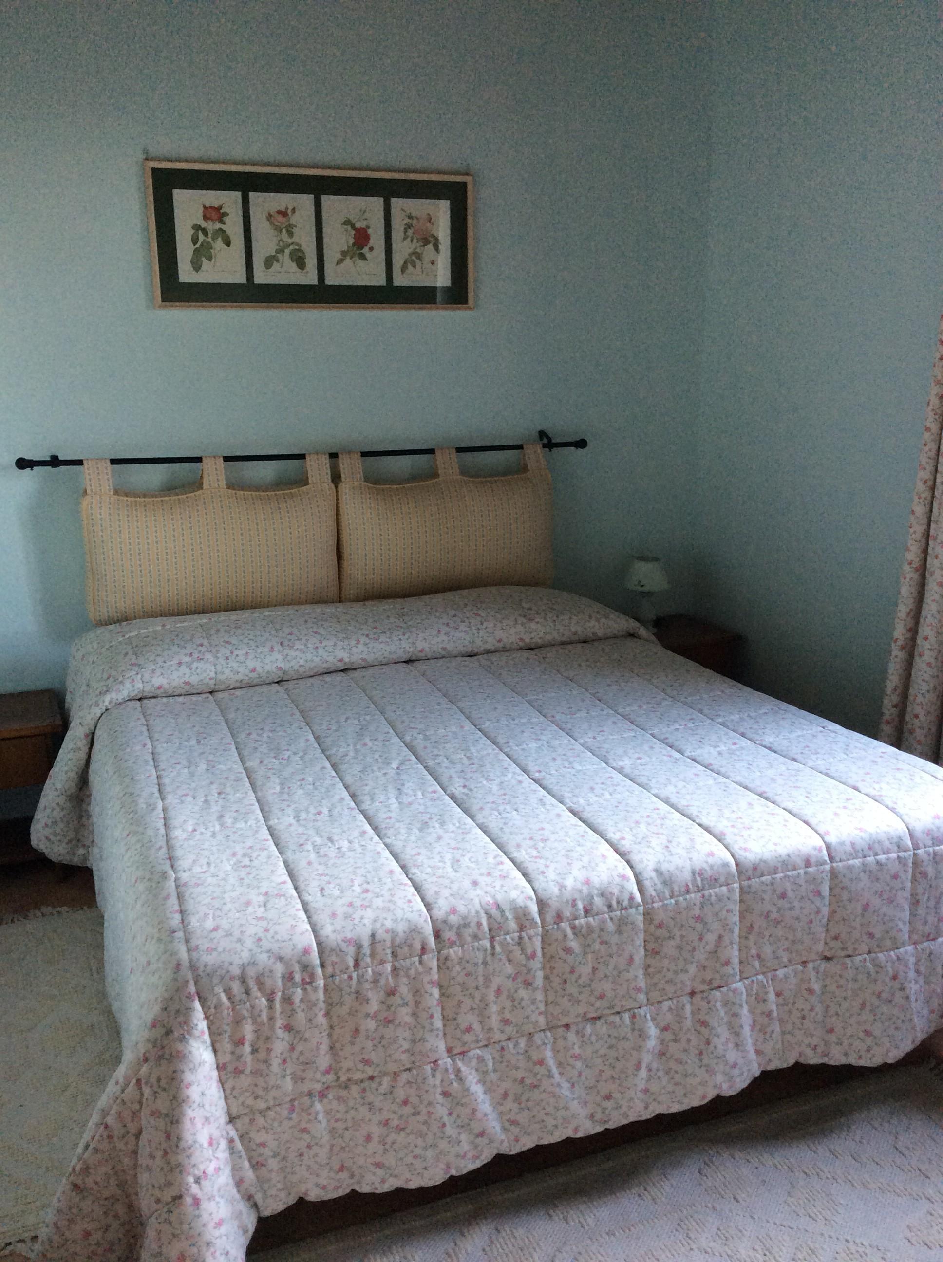 Una delle camere dell'appartamento per vacanze a Sacrofano